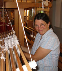 photo of student threading loom
